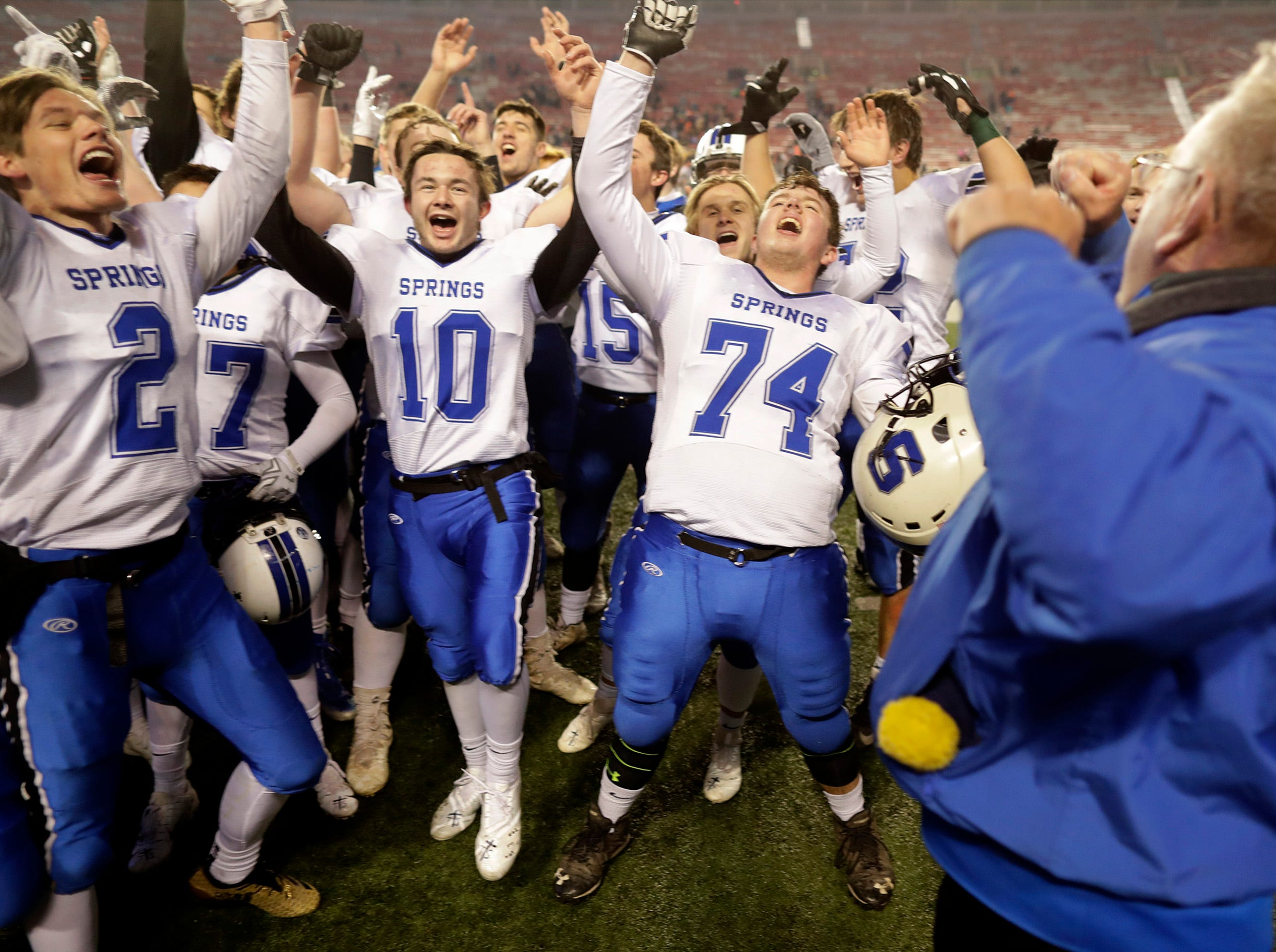 St. Mary's Springs Academy playerscelebrate the Ledgers' victory over Stratford High School during the WIAA Division  5 state championship football game on Thursday, November 15, 2018, at Camp Randall in Madison, Wis.