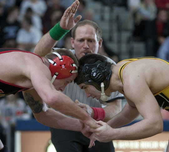 St. John Vianney wrestler Anthony Ferraro (right) competes during the 2011 region wrestling tournament.