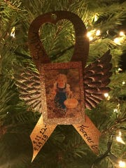This photo of Sally Kabel, a 6-year-old who recently lost her battle to cancer, hangs from one of the Forever Trees.