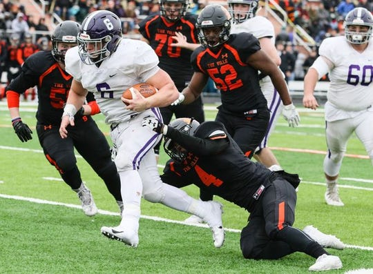 Rumson-Fair Haven running back Alex Maldjian, shown running during his 271-yard, four-TD performance against Somerville in the NJSIAA Central Group III championship game this past Sunday, is one of the nominees you can vote for for in the Asbury Park Press' Shore Conference Player of the Week Poll.