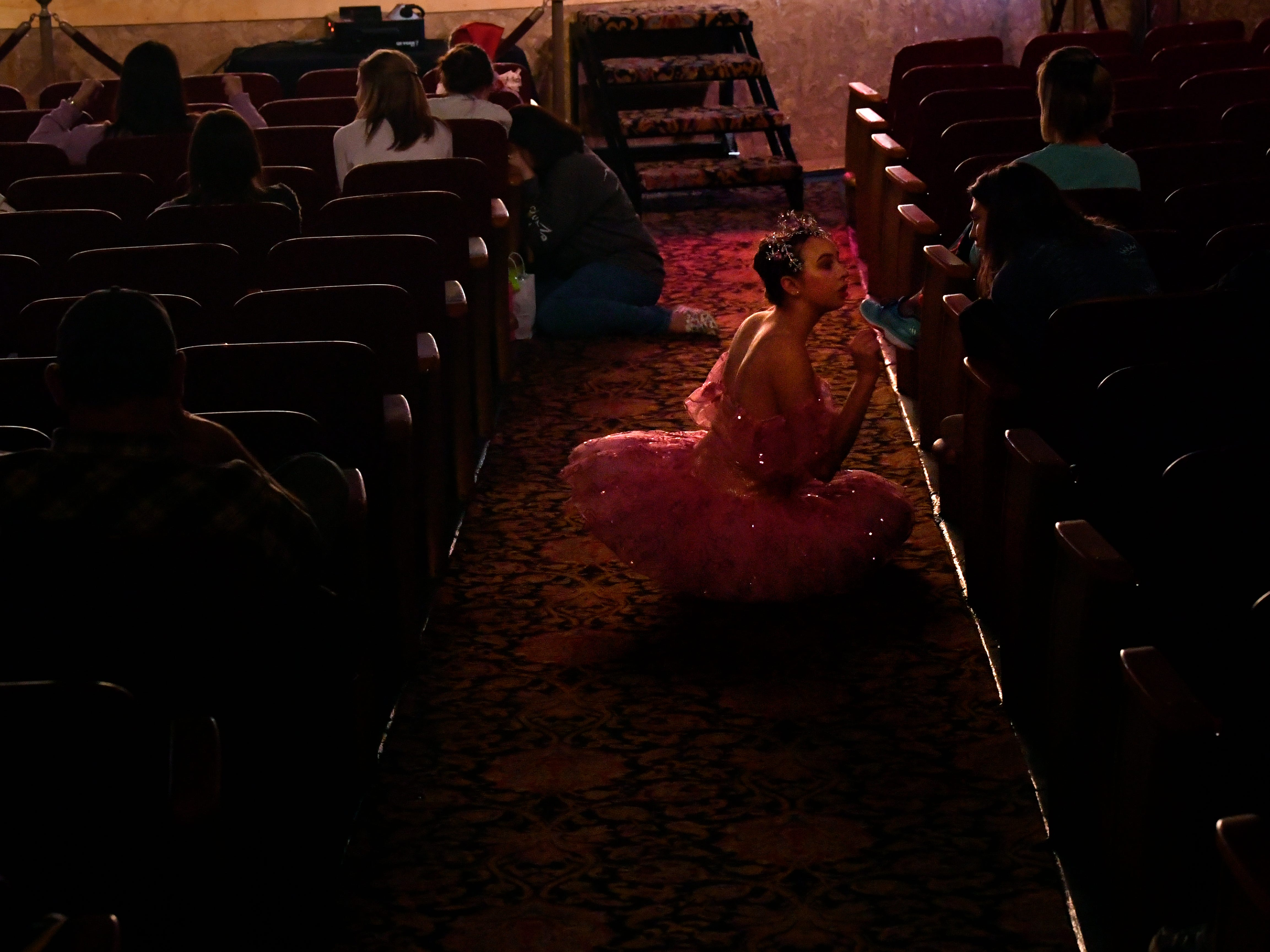 Dalli Albus, one of the dancers playing the Sugar Plum Fairy, rests during rehearsal for The Nutcracker Nov. 14, 2018. This was the 31st year for the Abilene Ballet Theatre production, held at the Paramount Theatre.