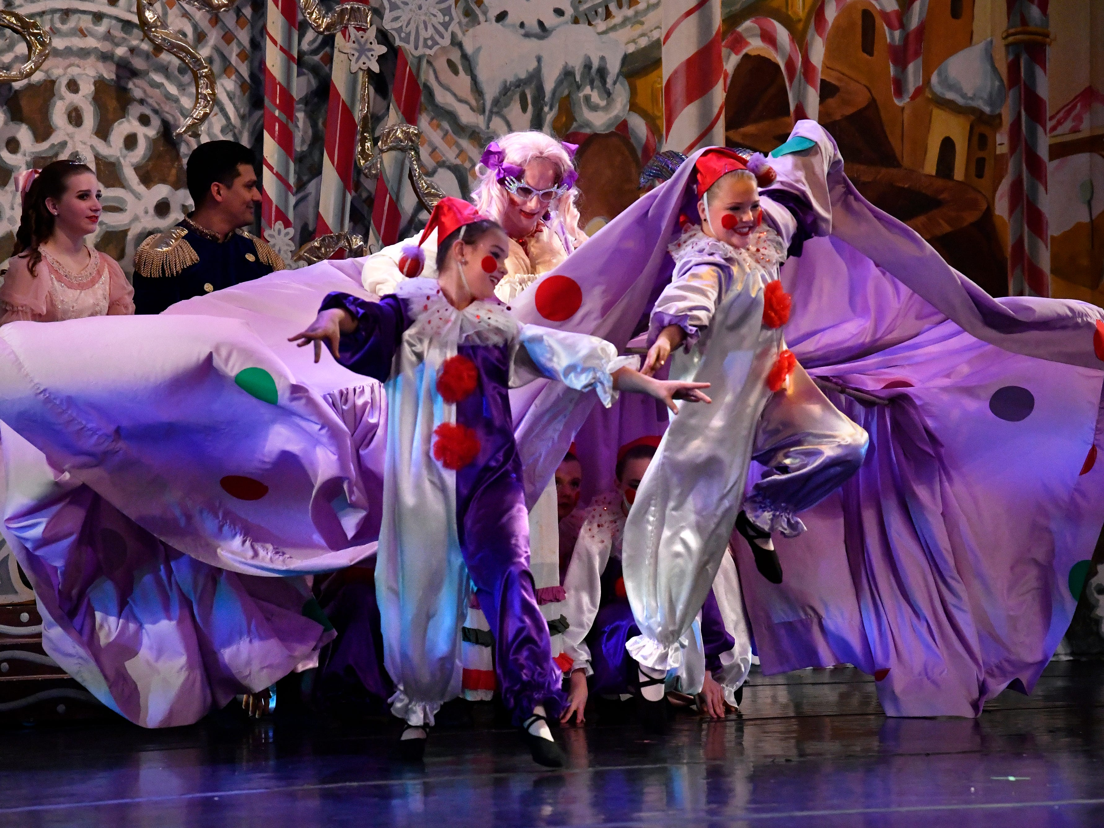 The Polichinelle clowns emerge from the skirts of Mother Ginger, played to comedic effect by Seth Willis, during the Friday morning performance of The Nutcracker for school children Nov. 19, 2018. This was the 31st year for the Abilene Ballet Theatre production, held at the Paramount Theatre.
