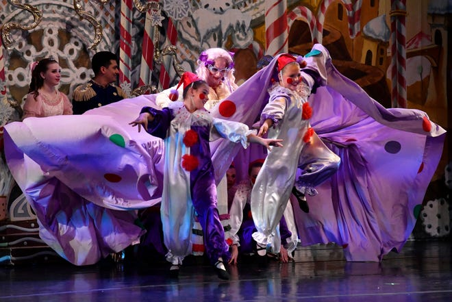 The Polichinelle clowns emerge from the skirts of Mother Ginger, played to comedic effect by Seth Willis, during the Friday morning performance of The Nutcracker for school children. This was the 31st year for the Abilene Ballet Theatre production.