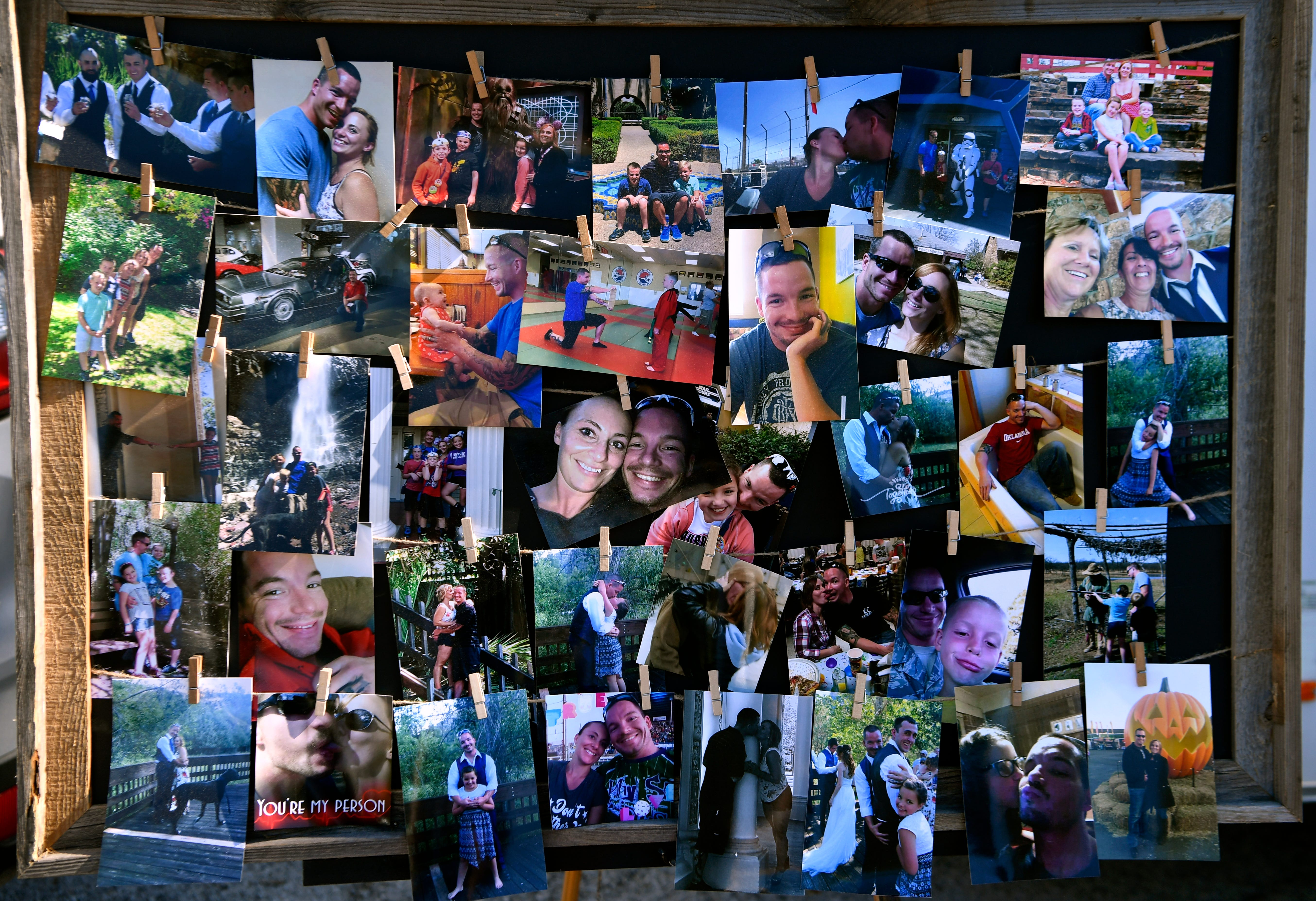 A memorial board of family photographs of Justin Elledge on display outside of his home Oct. 27.