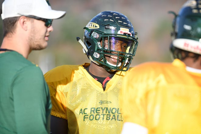 Reynolds junior wide receiver Jhari Patterson talks with coaches and teammates during practice at the school on Nov. 19, 2018.