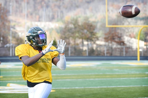 Reynolds junior wide receiver Jhari Patterson reaches for a pass during practice at the school on Nov. 19, 2018.