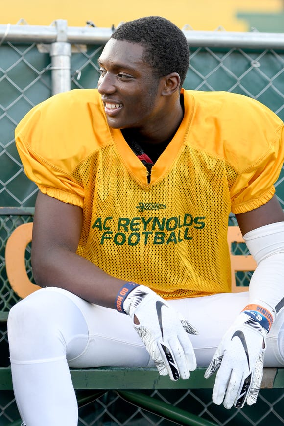 Reynolds junior wide receiver Jhari Patterson talks with teammates on the bench during practice at the school on Nov. 19, 2018.
