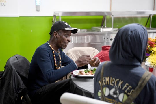 Robert Lee Johnson eats dinner at the Western Carolina Rescue Ministries during their second annual Week of Thankfulness on Nov. 19, 2018. Volunteers served dinner at WCRM every day of the week instead of just on Thanksgiving day.