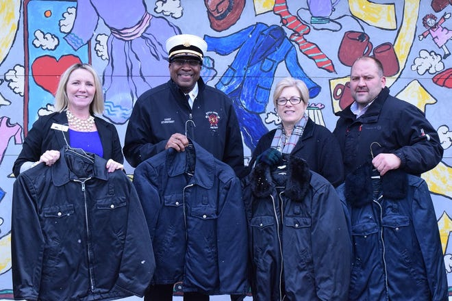 The city of Battle Creek found some old firefighter coats and wanted to donate them. Heritage Cleaners donated the cleaning service so they could be donated to Charitable Union and The Haven of Rest. Charitable Union Executive Director Teresa Allen, Fire Chief Brian Sturdivant, Heritage Cleaners owner Julie Plassman, Code Manager Jason Francisco.