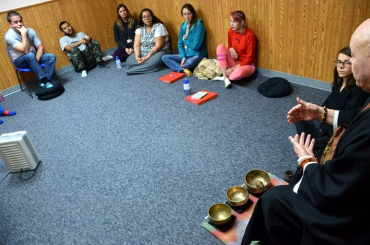 Sokuzan talks to a group of clients at A Forever Recovery on Thursday, Nov. 15, 2018, about meditation and creating awareness of yourself during the thrice-weekly Awareness track SokukoJi Buddhist Temple Monastery teaches at the recovery center.