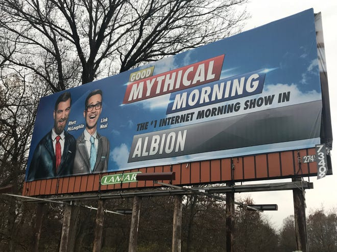 "A billboard for the YouTube series ""Good Mythical Morning"" near mile 123 in Albion."