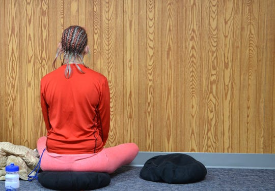 Angella Porter, a client at A Forever Recovery, faces the wall during a guided meditation session with Sokuzan, the abbot of SokukoJi Buddhist Temple Monastery, on Thursday, Nov. 15, 2018.