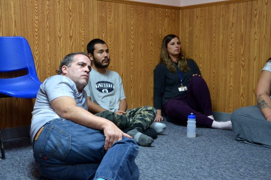 Clients at A Forever Recovery listen to Sokuzan, the abbot of SokukoJi Buddhist Temple Monastery, discuss awareness and the process of meditation on Thursday, Nov. 15, 2018.