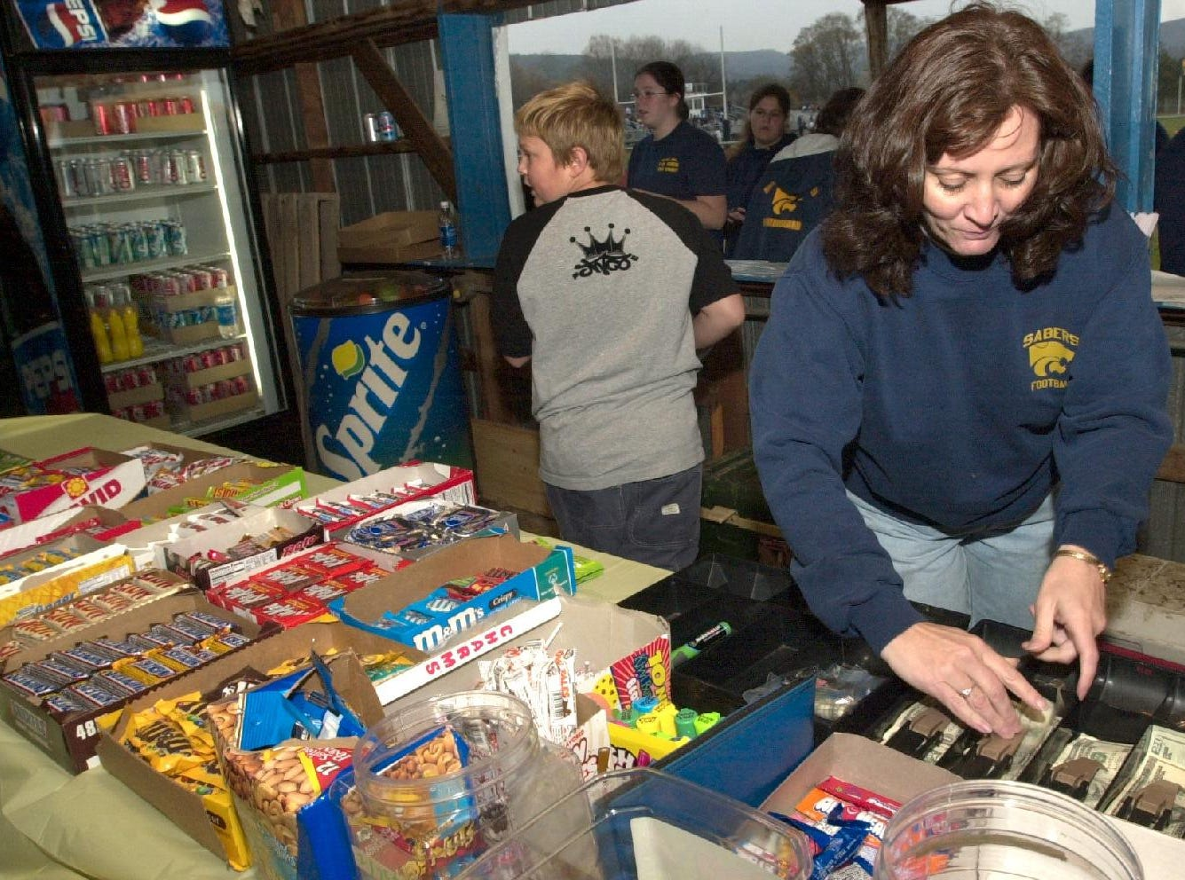 From 2003: Susquehanna Valley Booster Club Secretary Lorraine Perez makes change at the concession stand during a football game at the high school.