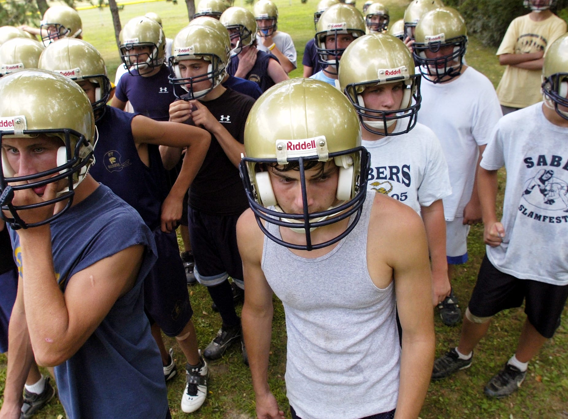 From 2006: Junior varsity football players gather during practice at Susquehanna Valley High School on Monday. Josh Marbaker, center, was one of several players displaced by the flood.