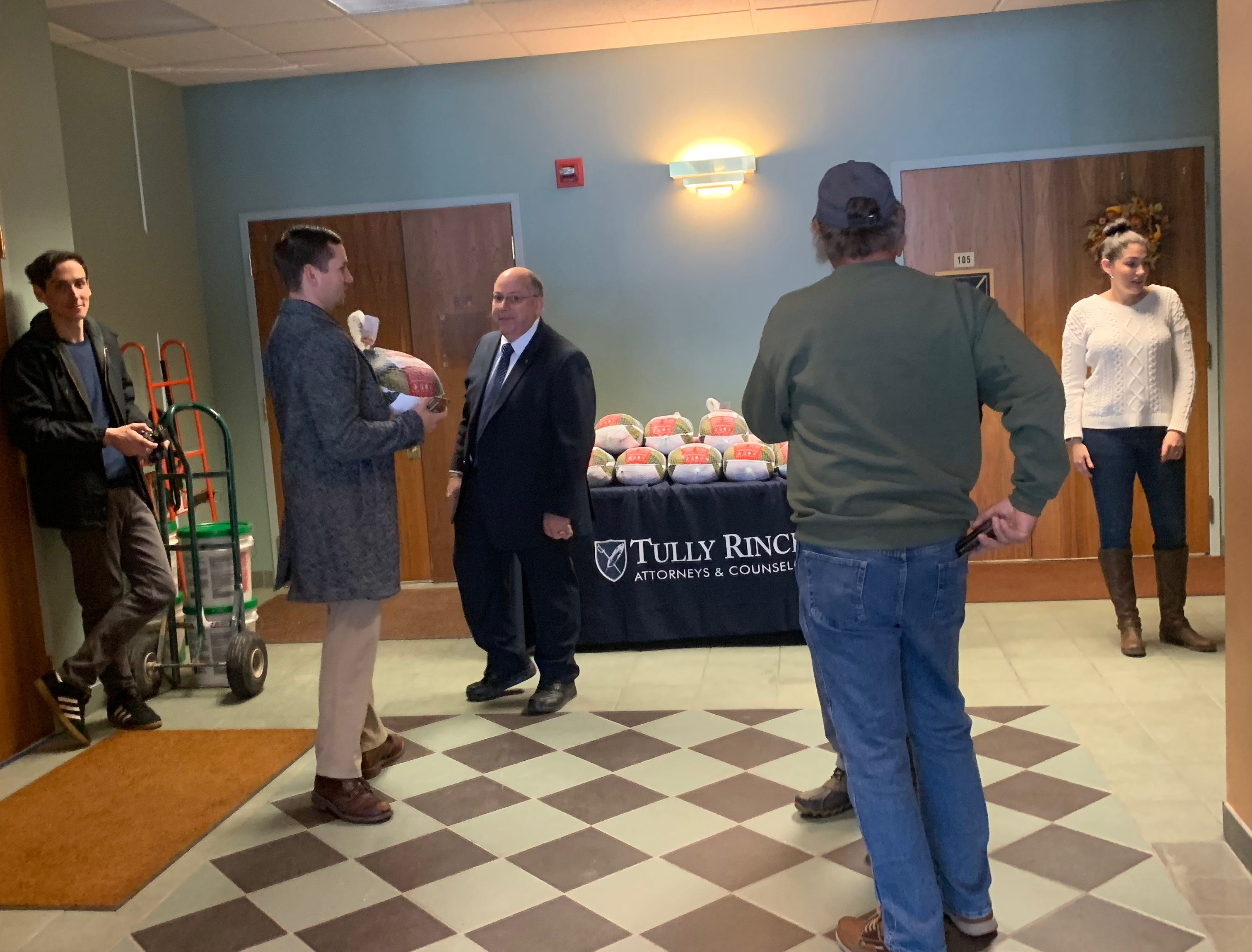 Tully Rinckey prepares to hand out turkeys to veterans at its Binghamton firm on Vestal Road Monday.