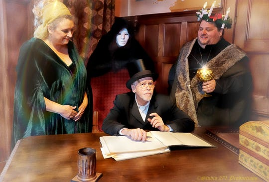 The Ghosts of Christmas Past (Jennifer Donlin), Christmas Present (Rob Egan) and Christmas Future (Nick DeLucia) visit Ebenezer Scrooge (Chris Nickerson) for four performances at the Roberson Mansion in Binghamton on Dec. 9 and Dec. 16.