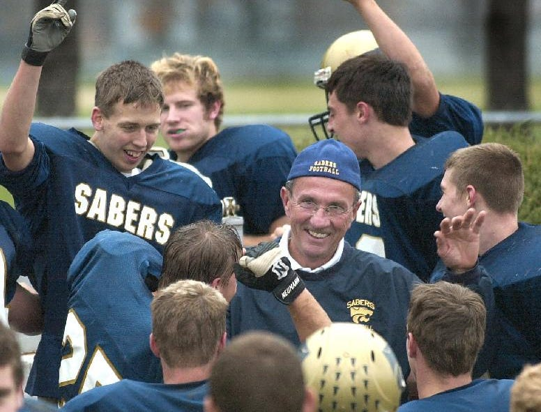 From 2003: Susquehanna Valley's Coach Jud Blanchard rings the bell at the north end of the field and gives hi-fives to his players after defeating Waverly Saturday afternoon at Susquehanna Valley High School.