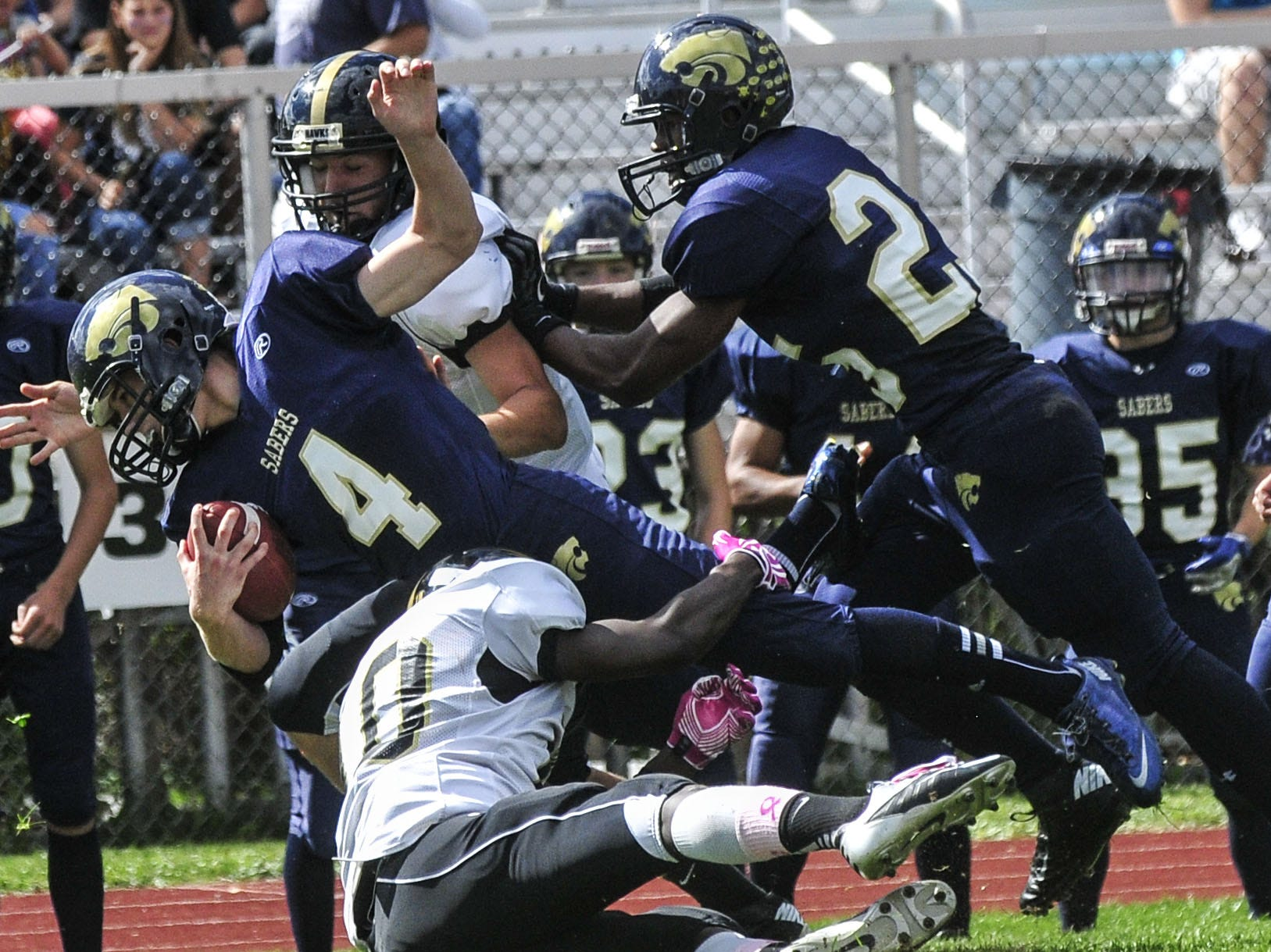 From 2013: Lain Zembek dives for a first down before being tackled by Corning?s Adarius France on Saturday afternoon at Susquehanna Valley High. The Sabers scored 20 first-half points but fell short, 28-27.