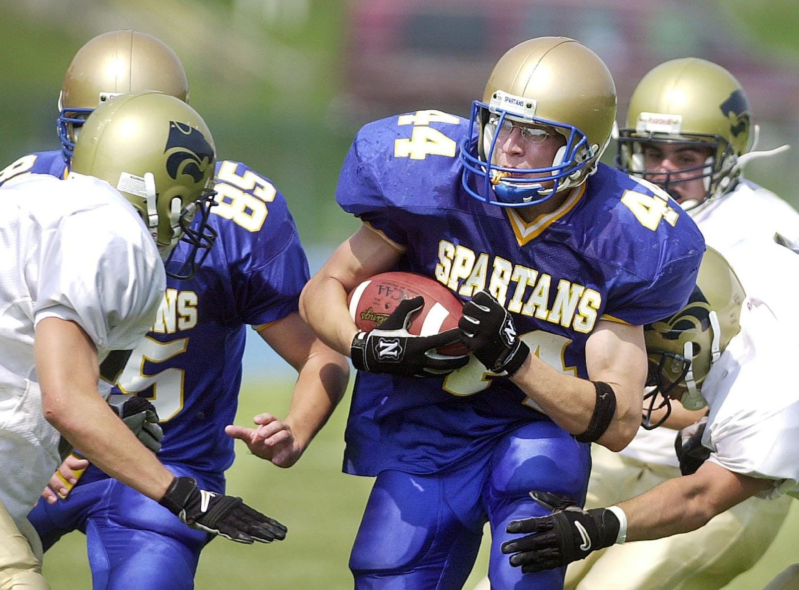 From 2001: SV Mike Masters, far left, and teammate Lucas Mooney pinch in on ME's Joe Frieser in the 2nd qtr of Sat's football game at ME.