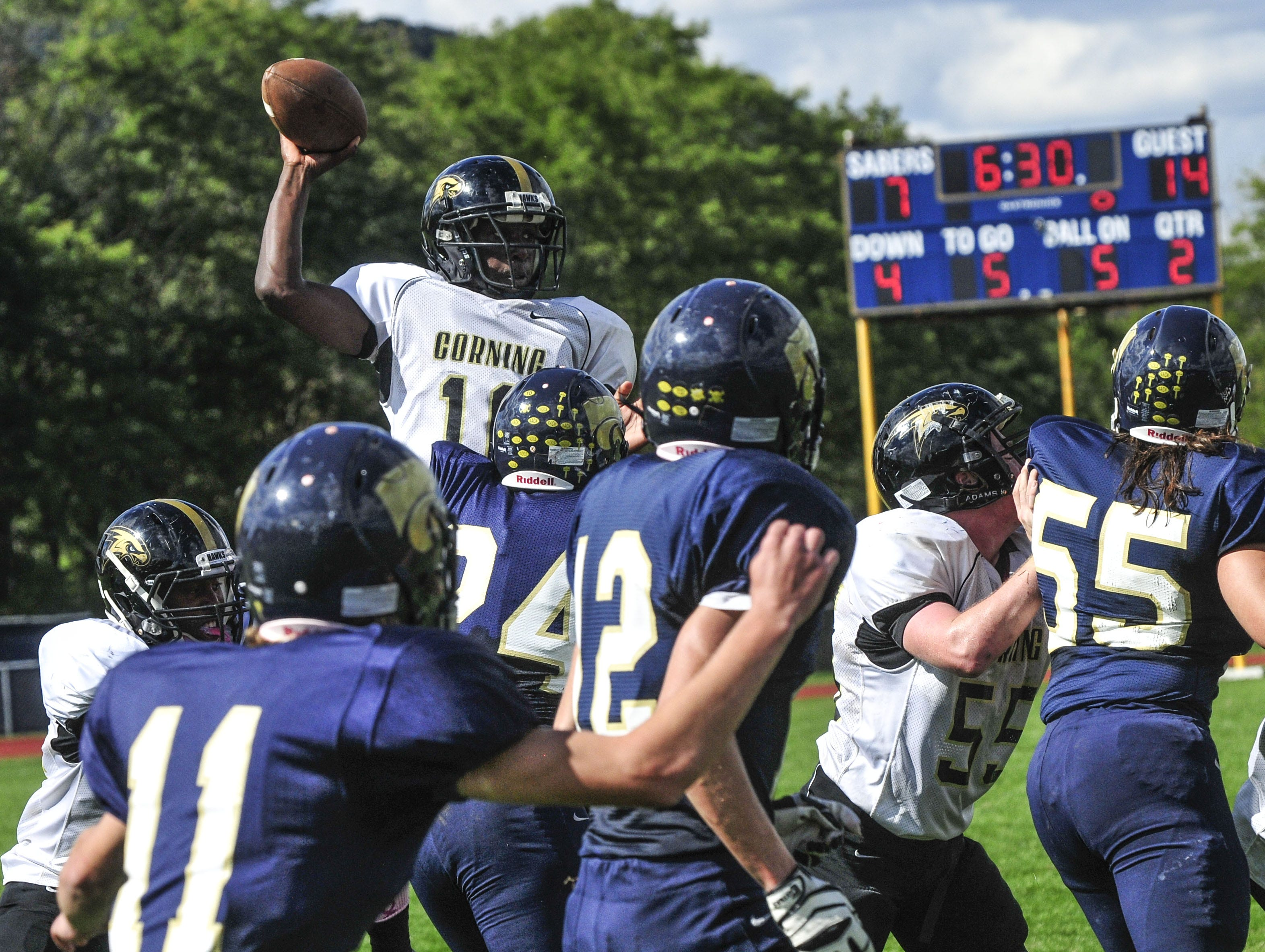 From 2013: Corning's Adarius France jumps to pass over the Susquehanna Valley defenders and connect with Sam Crusha for a touchdown Saturday.