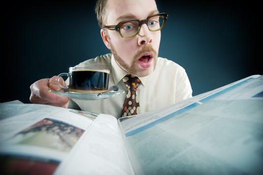 Retro Man Reading His Newspaper