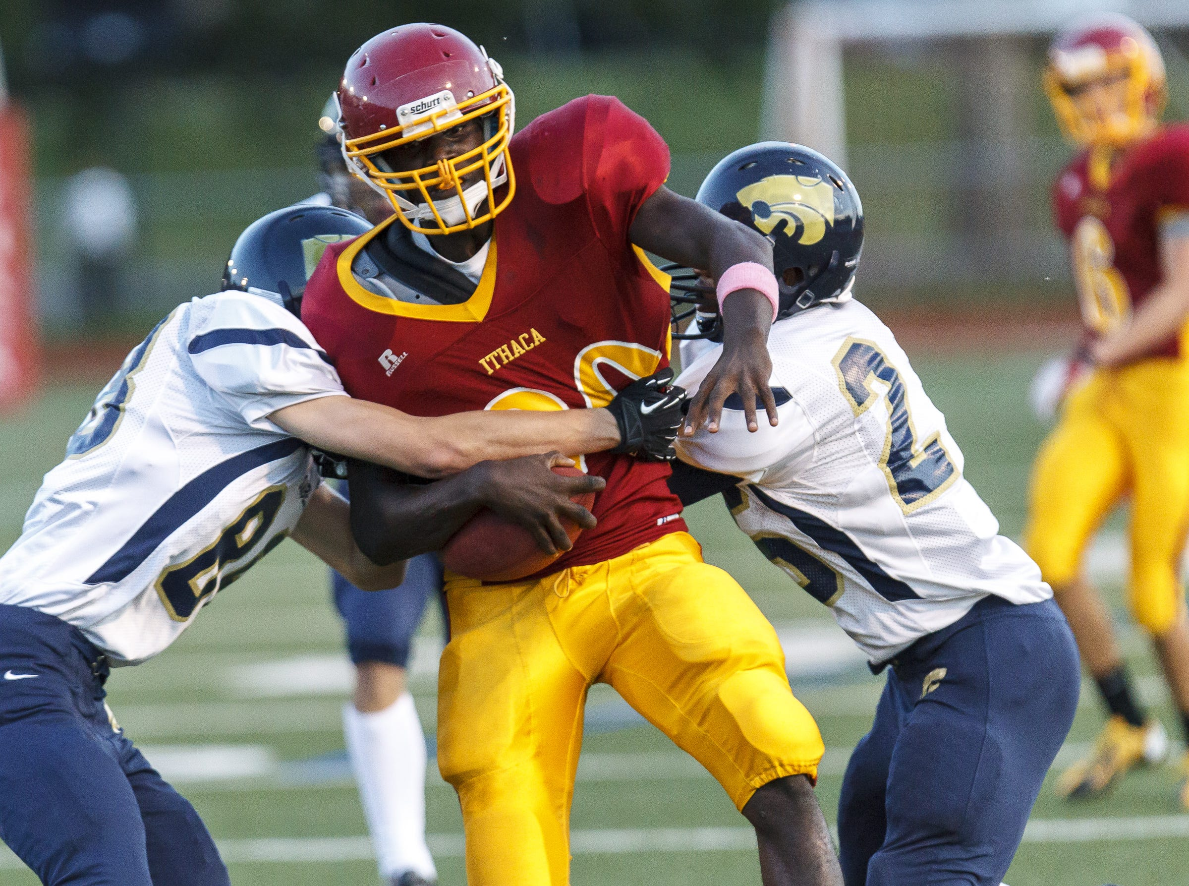 From 2013: Ithaca's DJ Davis is tackled by Susquehanna Valley's Corey Ewanow and Marquis Jackson on Friday.