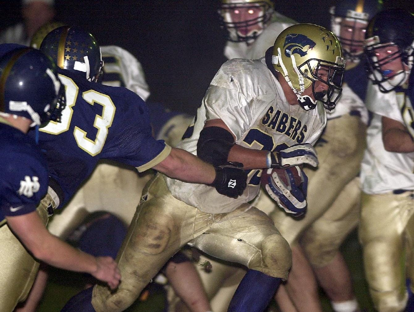 From 1999: Susquehanna Valley's 33, escapes a pack of Notre Dame defenders as he picks up a few yards bringing up second and 2 with 9:02 left in the first quarter of Friday night's game in Elmira.