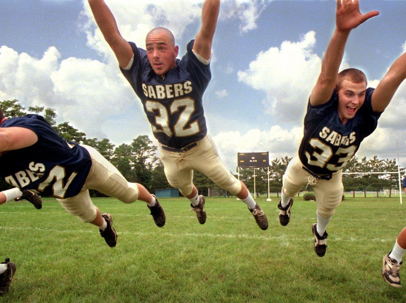 From 1996: Susquehanna Valley High School Football players Brian Beylo, no. 32, and Mark Schuster, no. 33, practice a flying drill.