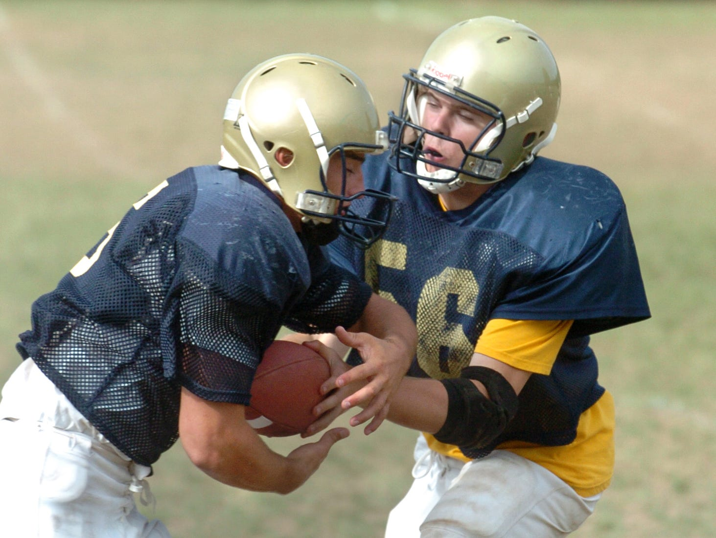 From 2005: Susquehanna Valley quarterback Ryan Wiggins, right, passes off to teammate John DePersiis during tuesday morning practice.