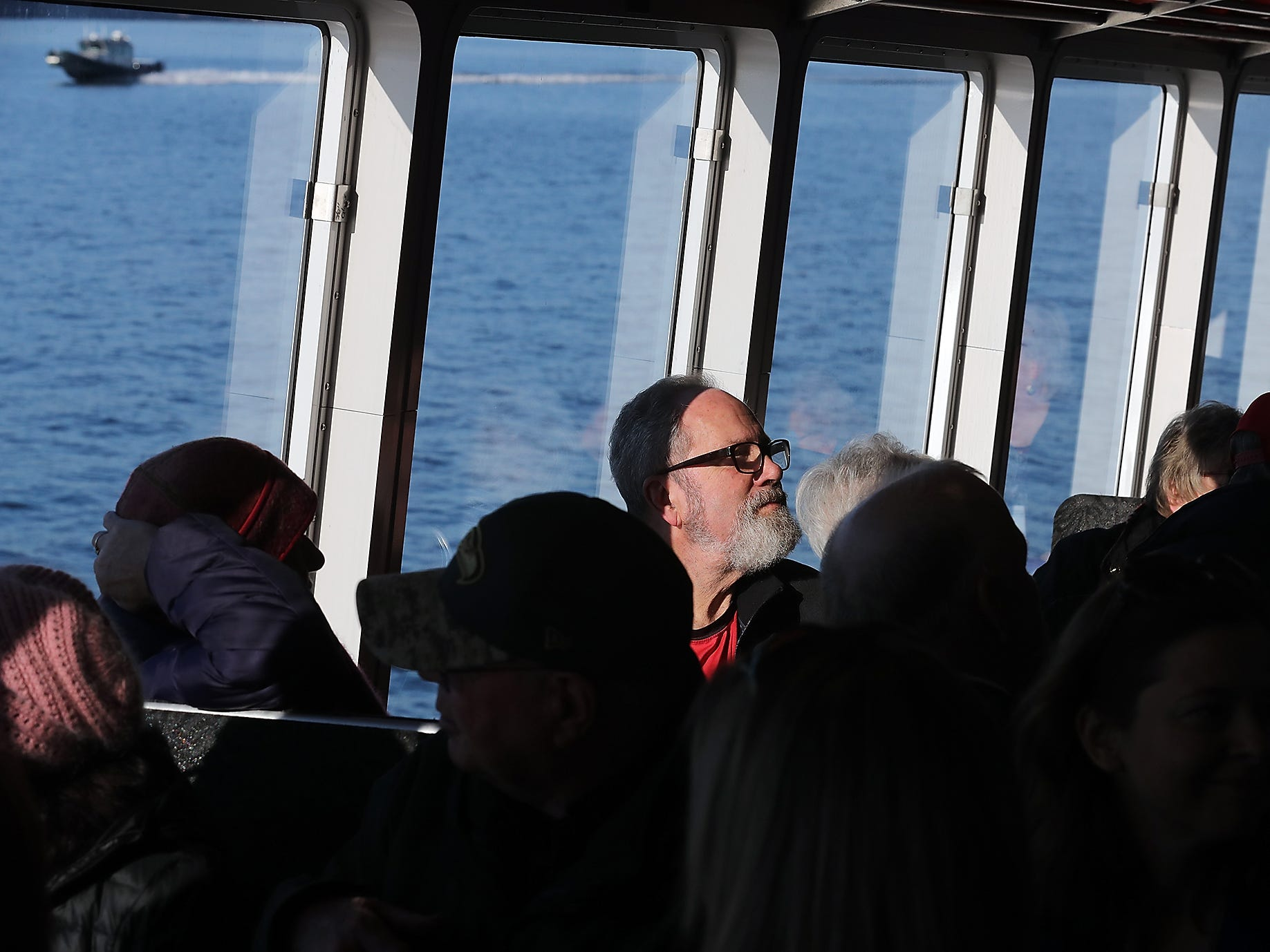 Richard Hayes, former executive director of Kitsap Transit, is illuminated by the sunshine through the window as he rides aboard the M/V Finest on Monday, November 19, 2018.