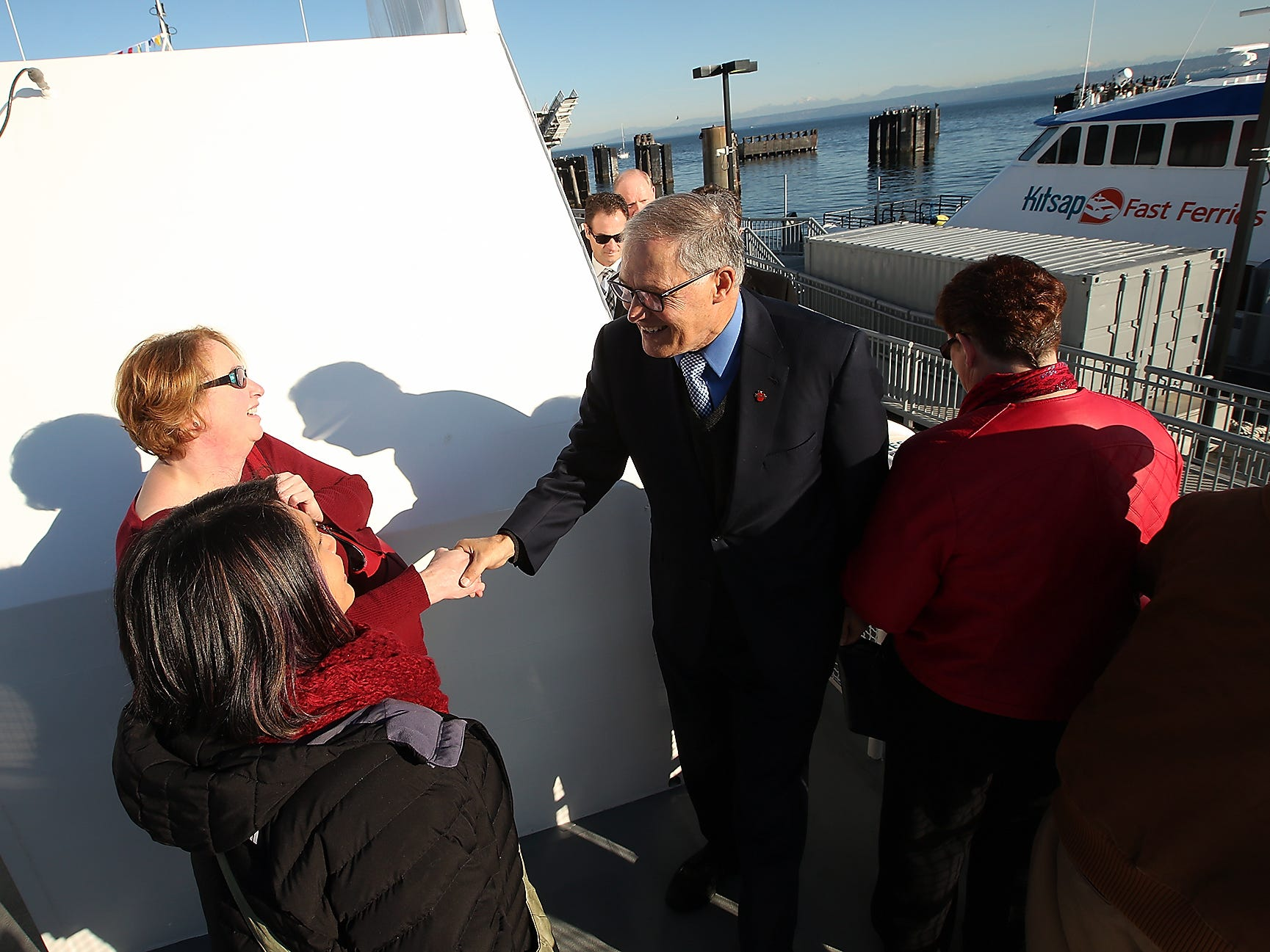 Sara Crouch, of Port Townsend, shakes Governor Jay Inslee's hand as he tours the M/V Finest at the Port of Kingston on Monday, November 19, 2018.