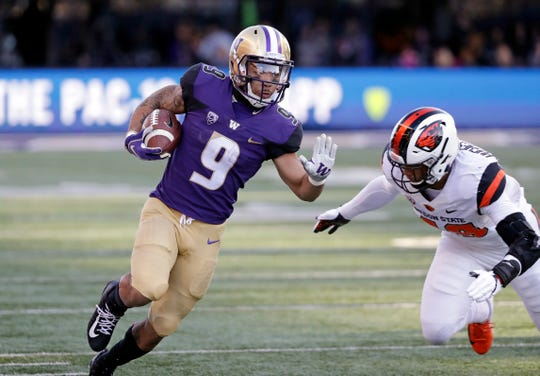 Washington tailback Myles Gaskin runs a gainst Oregon State in his final game at Husky Stadium on Nov. 17, 2018.