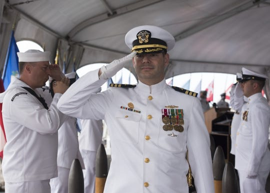PEARL HARBOR (Oct. 13, 2017) - Cmdr. Christopher C. Lindberg, Naval Submarine Support Command (NSSC) Pearl Harbor commanding officer, is piped aboard during the NSSC change of command ceremony aboard the Battleship Missouri Memorial in Pearl Harbor, Hawaii. Lindberg relieved Cmdr. Michael D. Eberlein of NSSC.