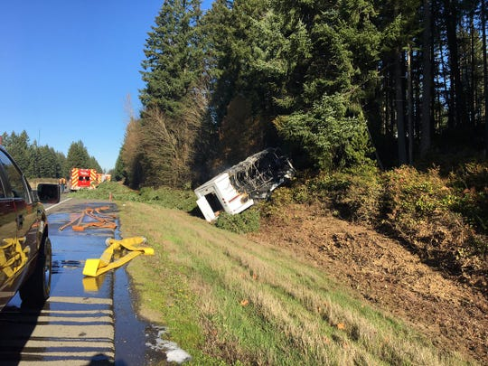 The Washington State Patrol shared this photo of a Kitsap Airporter bus that crashed into a tree on Monday morning.