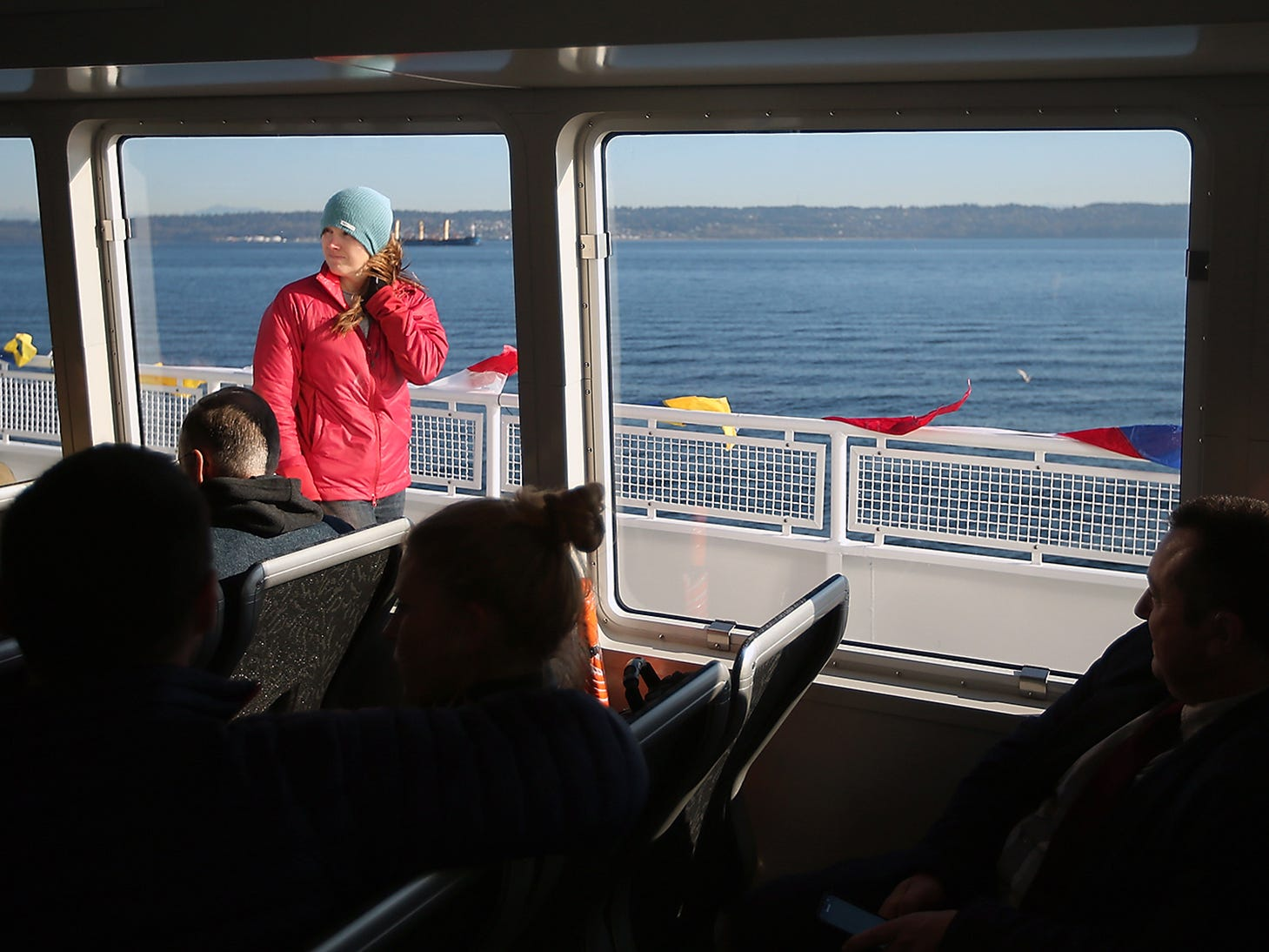 Shannan Yates, of Salt Lake City UT., is framed by the cabin windows during the grand opening ride aboard the M/V Finest on Monday, November 19, 2018.