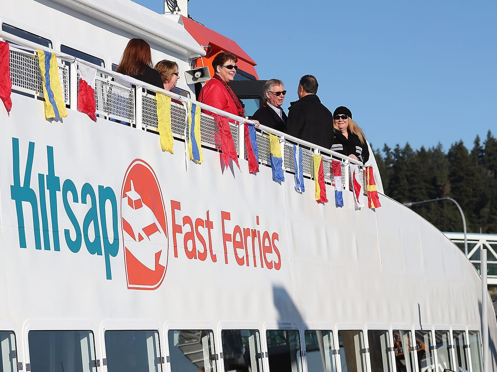Riders take in the view from atop the M/V Finest as the ferry prepares to leave the dock during the Grand Opening event at the Port of Kingston for Kitsap Transit's new fast-ferry service between Kingston and Seattle on Monday, November 19, 2018.