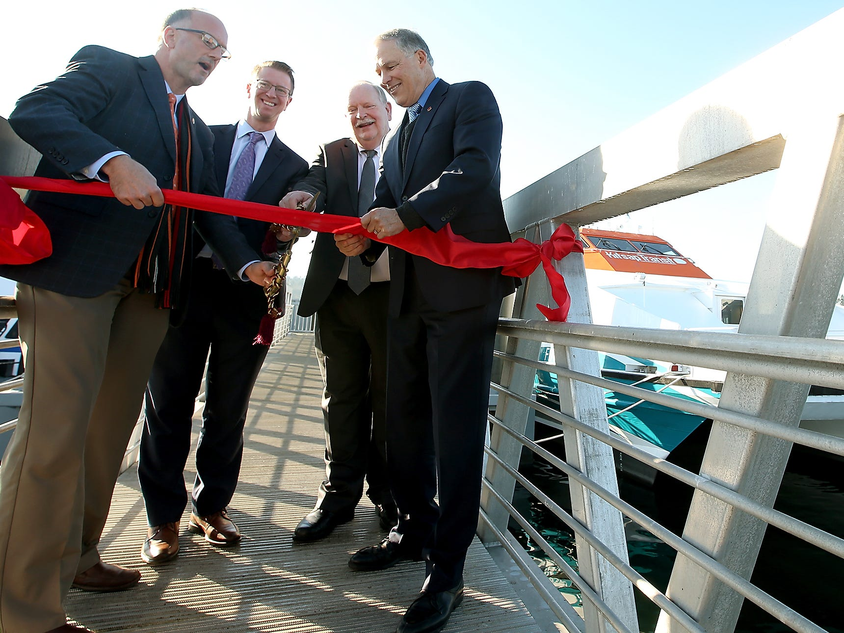 The ribbon is cut during the Grand Opening at the Port of Kingston for Kitsap Transit's new fast-ferry service between Kingston and Seattle on Monday, November 19, 2018.