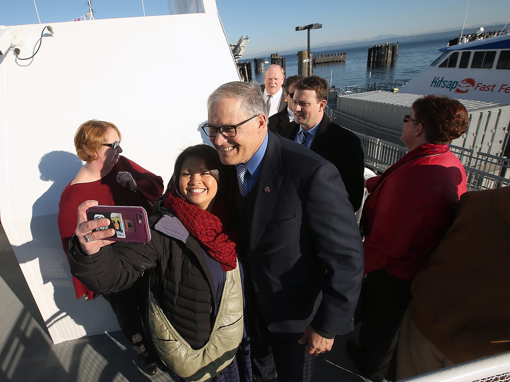 Theresa Smith, of Bremerton, takes a quick selfie with Governor Jay Inslee as he tours the M/V Finest during the Grand Opening at the Port of Kingston for Kitsap Transit's new fast-ferry service between Kingston and Seattle on Monday, November 19, 2018.