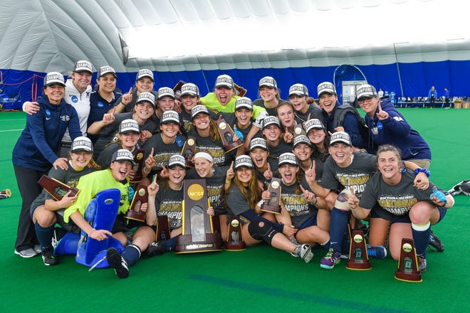 Middlebury celebrates winning back-to-back NCAA field hockey crowns on Sunday.