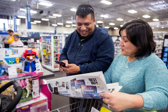 "Israel Rodriguez (left) and Connie Rodriguez shop for Christmas items at Best Buy on Monday, November 19, 2018. Connie Rodriguez didn't know Best Buy already had several Black Friday items on sale until they arrived at the store, she said her husband shops the Black Friday sales every year. ""They're coming out sooner and sooner,"" she said. ""It really helps. He'll still likely go out. It's his tradition."""