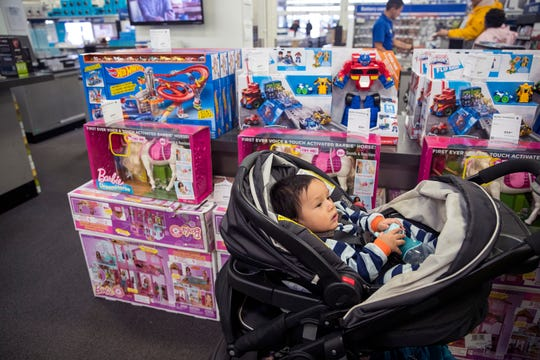 Dante Rodriguez, 14 months, hangs out while his parent's shop for Christmas at Best Buy on Monday, November 19, 2018. They were surprised to see the store already had several Black Friday items on sale.