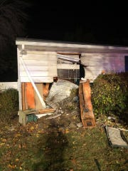 A Berlin home was damaged when a vehicle crashed into it early Sunday.