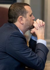 Jeff Fisher waits inside Ross County Common Pleas Judge Mike Ater's courtroom before entering an Alford guilty plea to two counts of sexual battery on Nov. 19, 2018. While Fisher maintains he's innocent with the Alford plea, the plea acknowledges prosecutors had the evidence to convict him on the allegations he had sex with two teenage girls while he was a teacher and then principal at Chillicothe High School.
