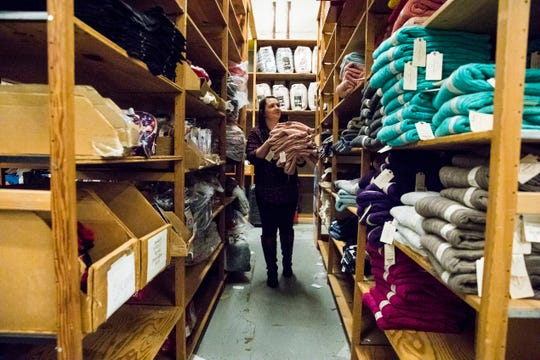 Elizabeth Long looks to place some overflow sweater merchandise in the JC Penney's stock room Monday afternoon in preparation for their big sales events Thursday and Friday in Chillicothe.