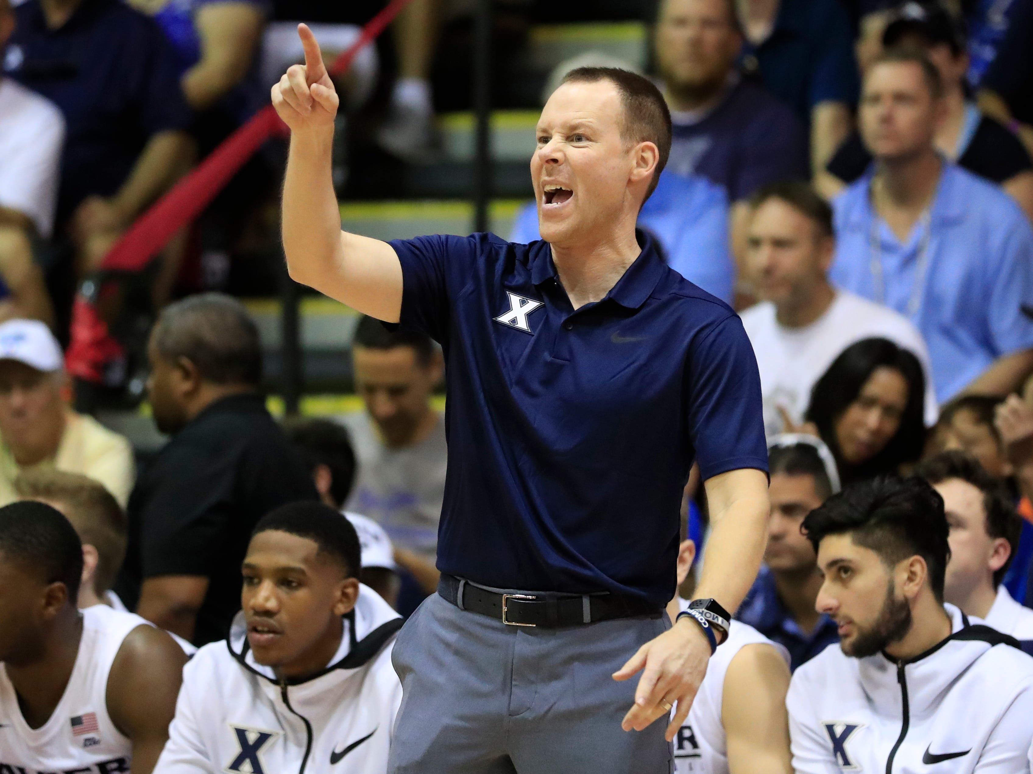 Xavier head coach Travis Steele gives direction to his team during the first half of an NCAA college basketball game against Auburn at the Maui Invitational, Monday, Nov. 19, 2018, in Lahaina, Hawaii.