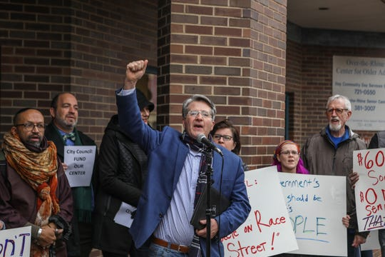Brian Garry leads a chant with protesters outside of the OTR Senior Citizen Center in protest of its Nov. 28 closing.