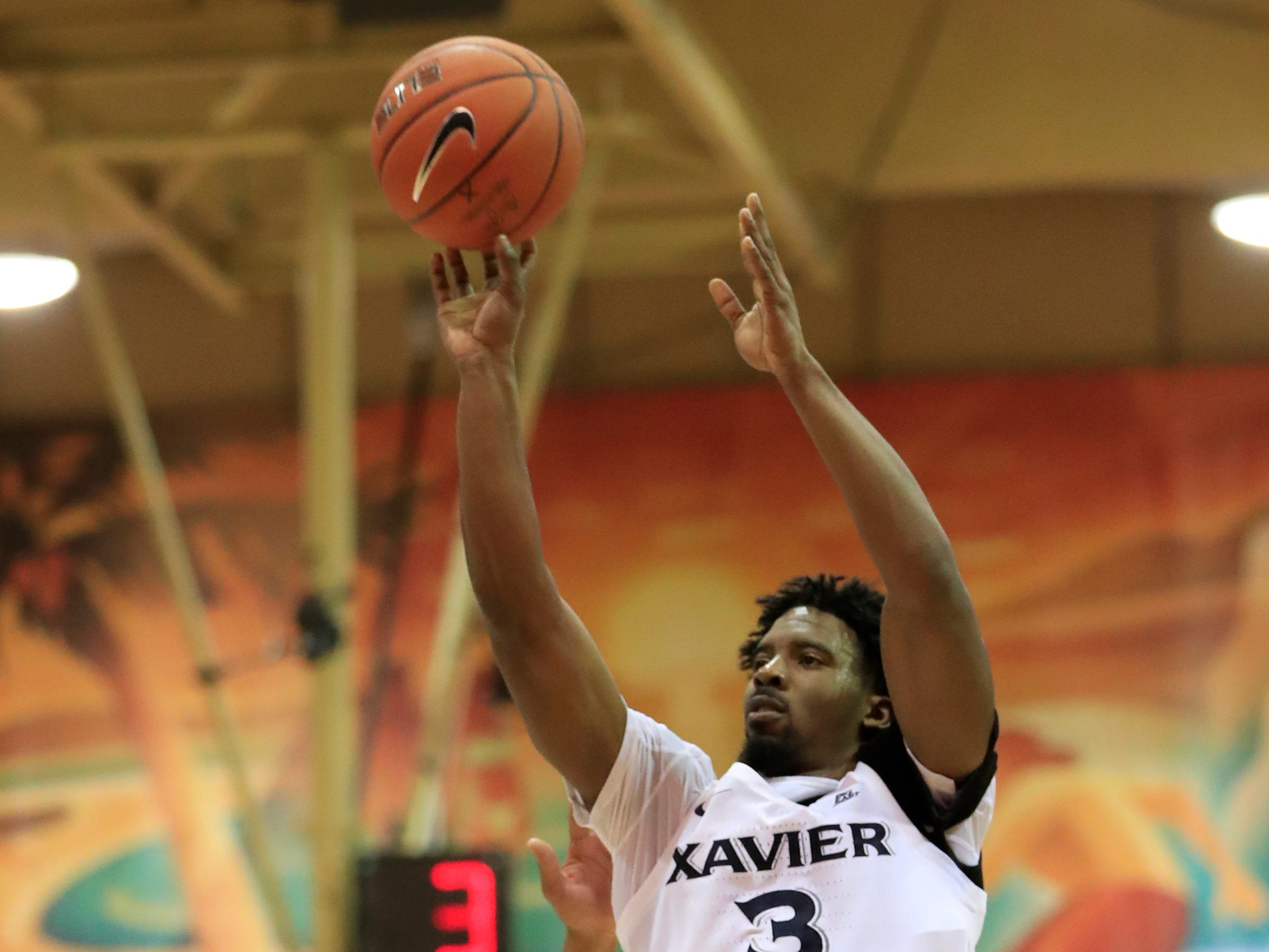 Xavier guard Quentin Goodin (3) shoots over the Auburn defense during the first half of an NCAA college basketball game at the Maui Invitational, Monday, Nov. 19, 2018, in Lahaina, Hawaii.