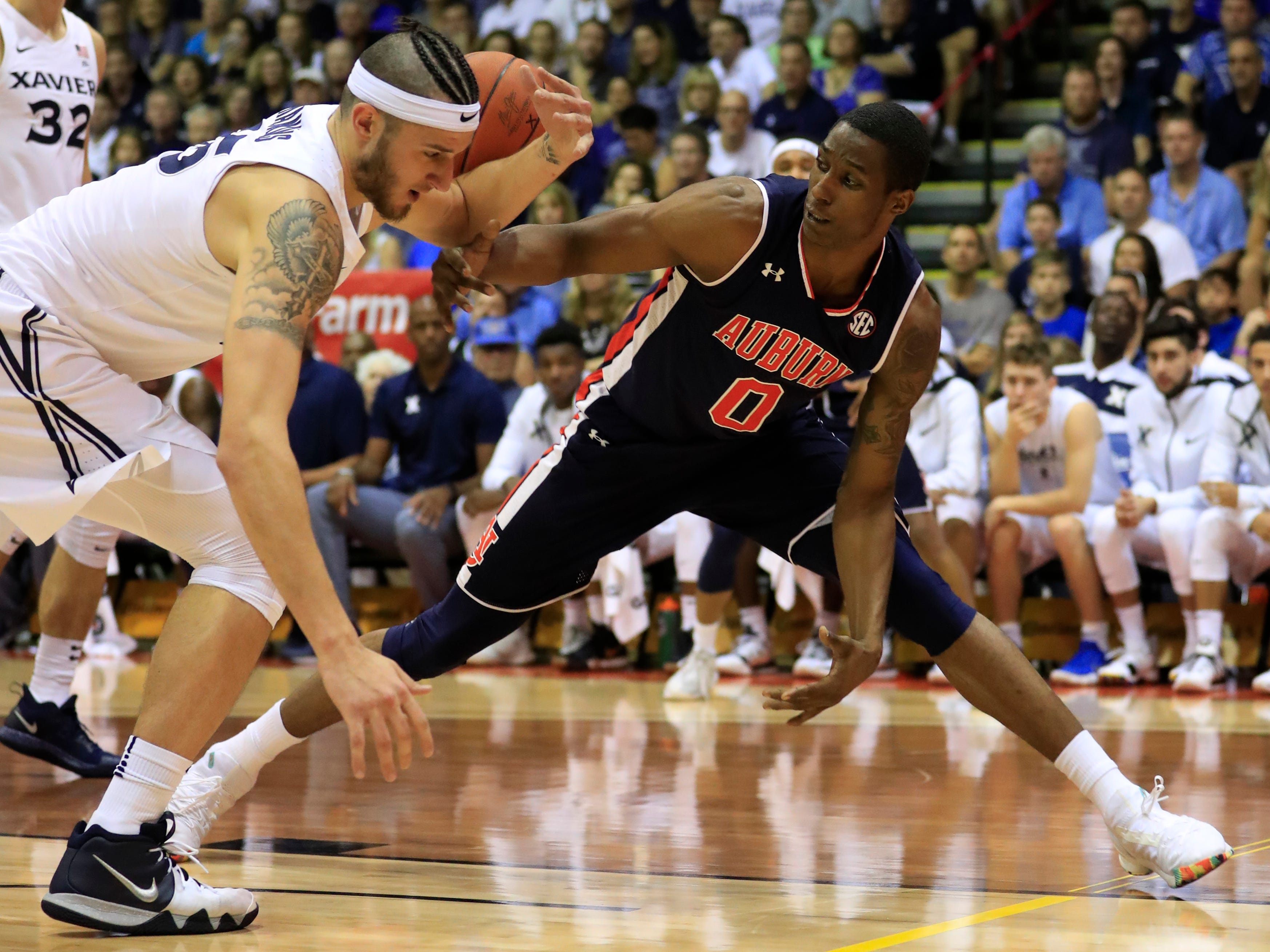 Xavier forward Zach Hankins (35) fights for a loose ball against Auburn forward Horace Spencer (0) during the first half of an NCAA college basketball game at the Maui Invitational, Monday, Nov. 19, 2018, in Lahaina, Hawaii.