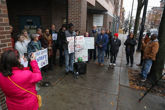 Over-the-Rhine Community Council President Maurice Wagner speaks at the rally outside of the OTR Senior Citizen Center in protest of its Nov. 28 closing.